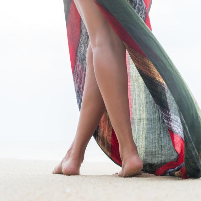 """Standing woman legs posing on the beach"" stock image"