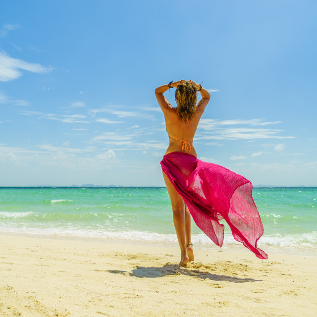 """""""Woman with pink sarong at the beach in Koh Poda island Thailand"""" stock image"""