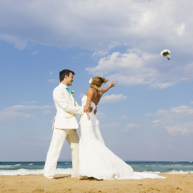 """""""Bride and groom at the beach"""" stock image"""