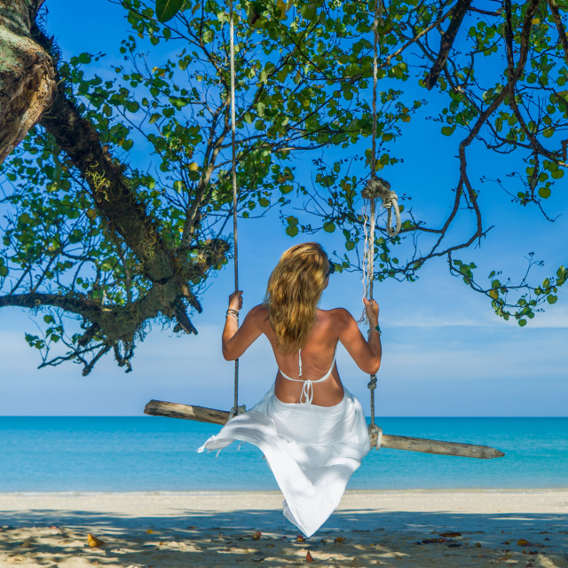 """""""Woman swinging at the beach"""" stock image"""