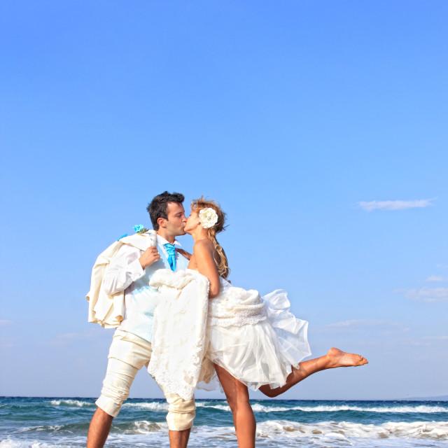 """Couple at their beach wedding"" stock image"