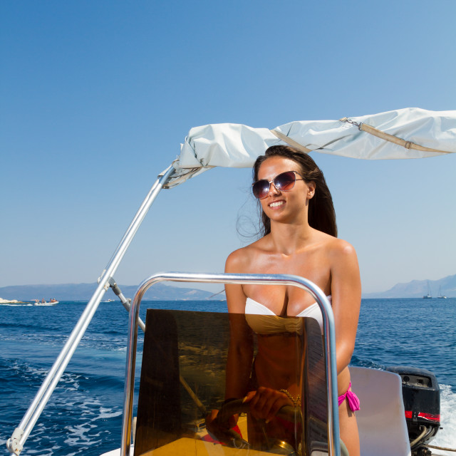 """""""Young woman driving a motor boat"""" stock image"""