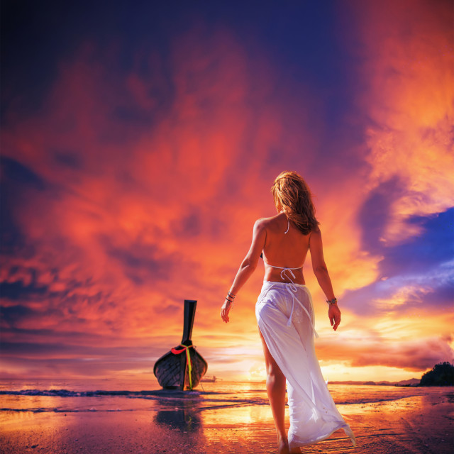"""""""Young woman in white trousers walking on the beach"""" stock image"""