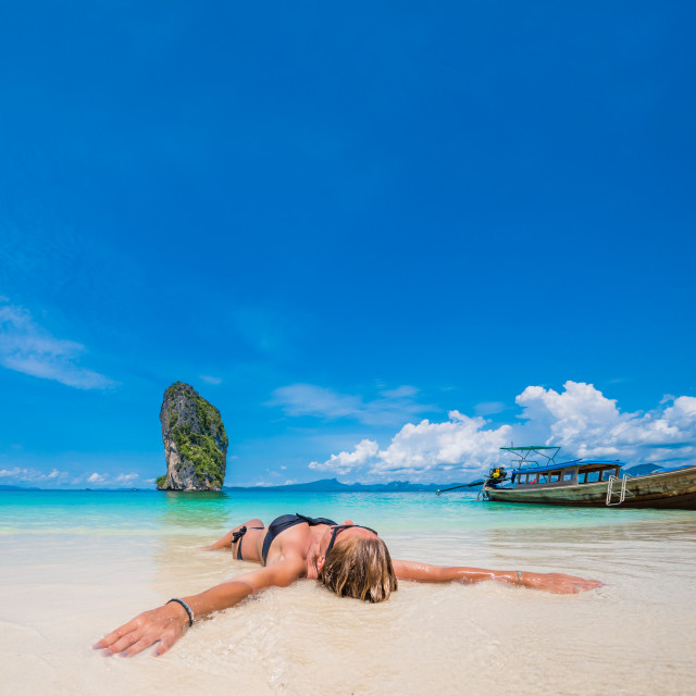 """""""Cute woman relaxing on the beach"""" stock image"""