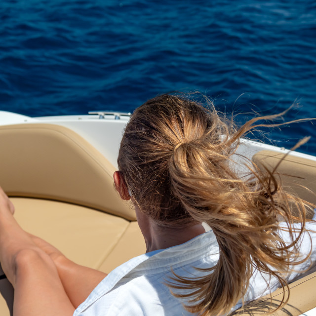 """""""Woman relaxing on a yacht in the summer"""" stock image"""