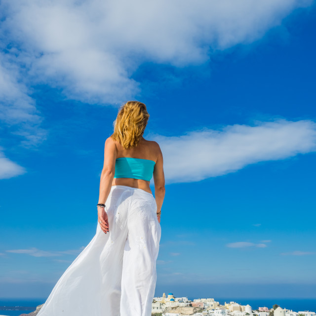 """""""WOman on the rooftop in Santorini Greece"""" stock image"""