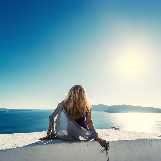 """""""Luxury travel vacation woman looking at view on Santorini island"""" stock image"""