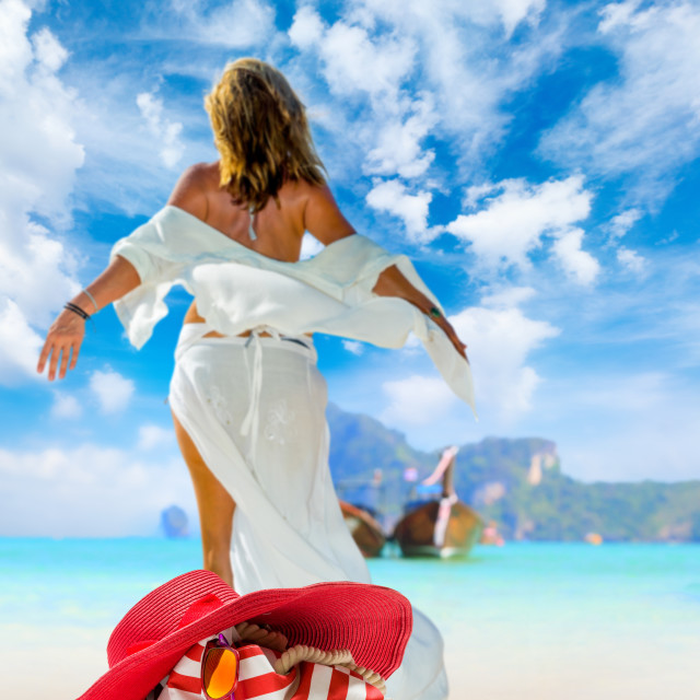 """""""view of a womanstanding on the beach"""" stock image"""