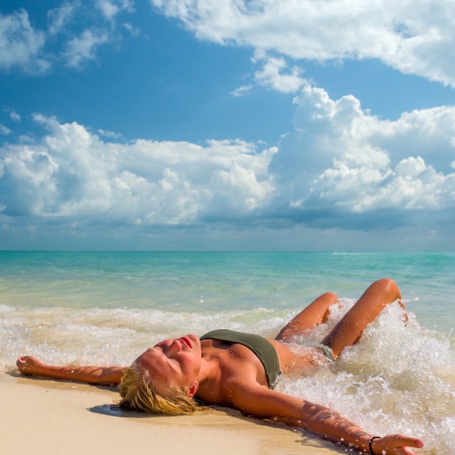 """""""Young woman at the tropical beach"""" stock image"""