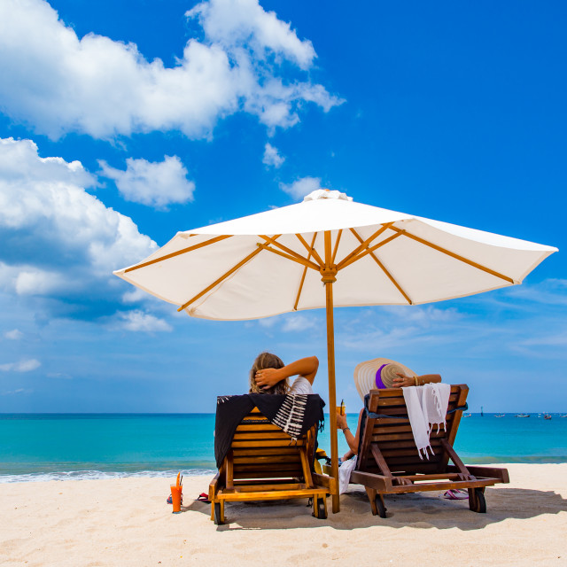 """""""Couple of tourists on the beach"""" stock image"""