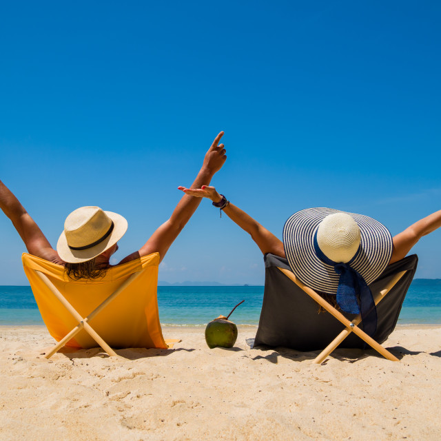 """""""Couple at the white sand beach"""" stock image"""