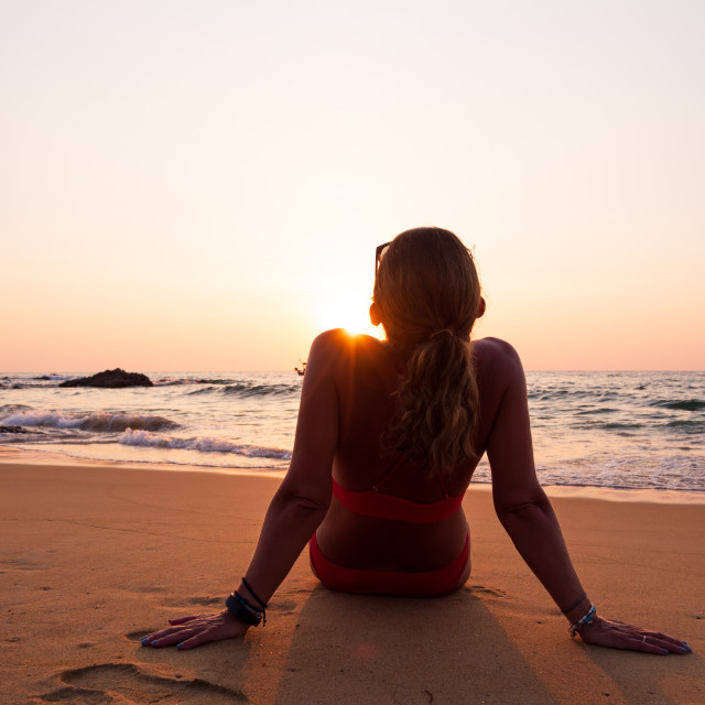 """""""young woman on the sea at sunset"""" stock image"""
