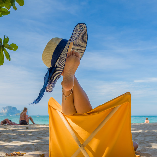 """""""Legs of a woman at the beach"""" stock image"""