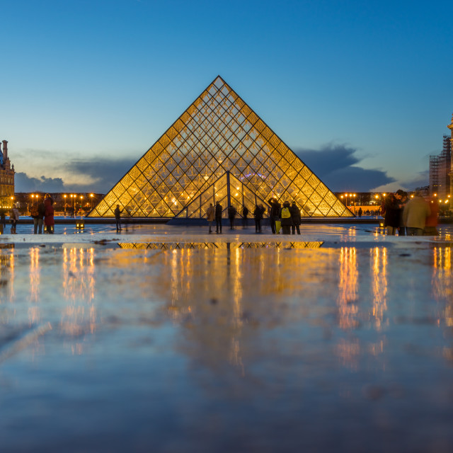 """iew of famous Louvre Museum with Louvre Pyramid at evening"" stock image"