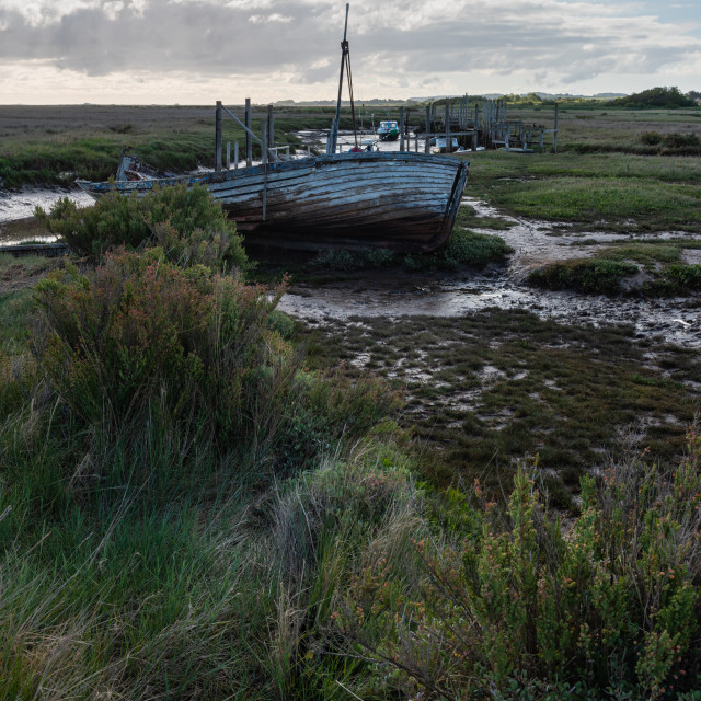 """Abandoned fishing boat at Thornham Old Harbour in Norfolk i"" stock image"