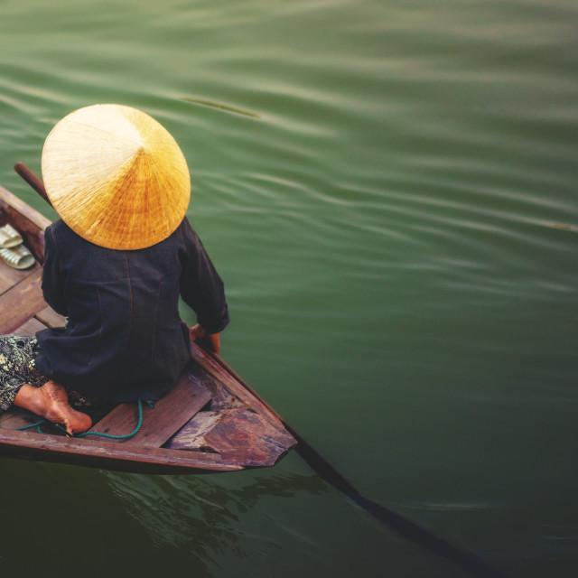 """A woman rowing boat in Cai Rang"" stock image"