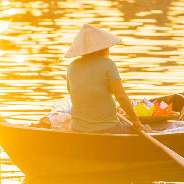 """""""Vietnamese woman in traditional bamboo hat rowing on the Thu Bon"""" stock image"""