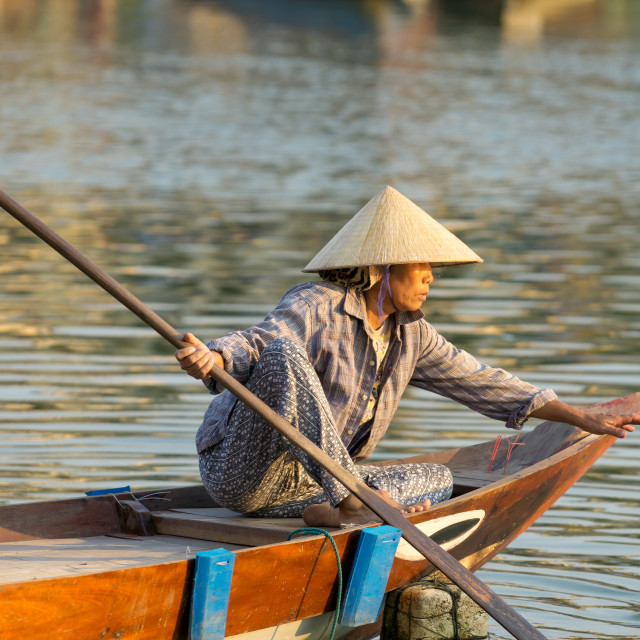 """""""The boatwoman on the old national vietnamese boat"""" stock image"""
