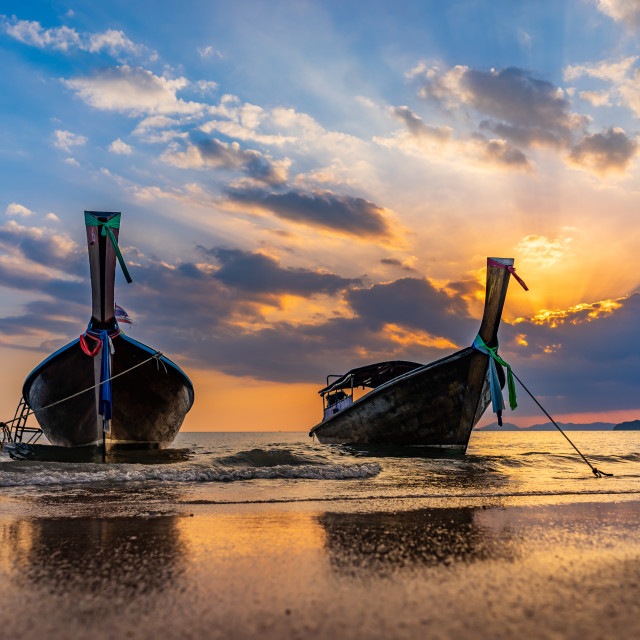 """Long tail boat at sunset in Thailand"" stock image"