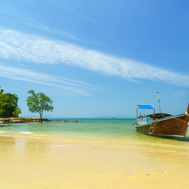 """Traditional long-tail boat on the beach"" stock image"