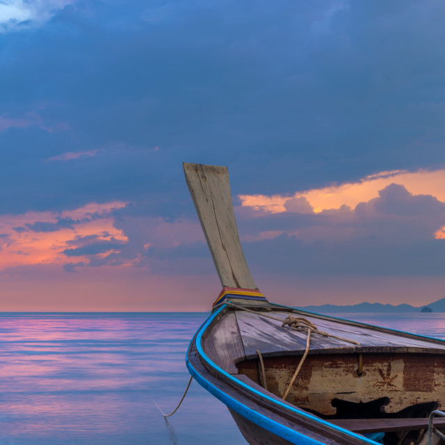 """Traditional long-tail boat on the beach in Krabi Thailand"" stock image"