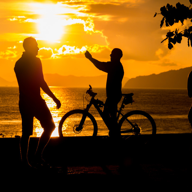 """People at Sunset on the beach of Ao Nang in Krabi"" stock image"