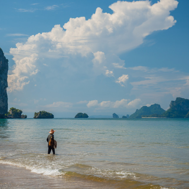 """Fisherman on the beach in Ao Nanag"" stock image"