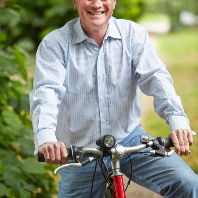 """""""Senior Man Enjoying Cycle Ride"""" stock image"""