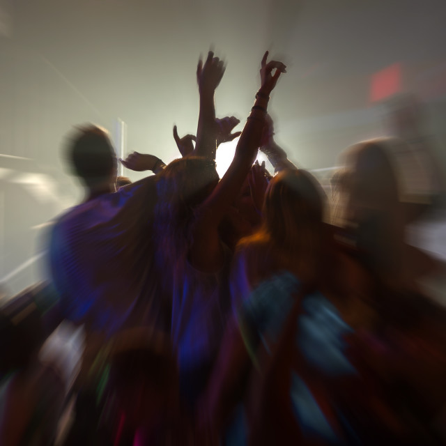 """dancing people radial blur effect in Laganas Zakynthos Greece"" stock image"
