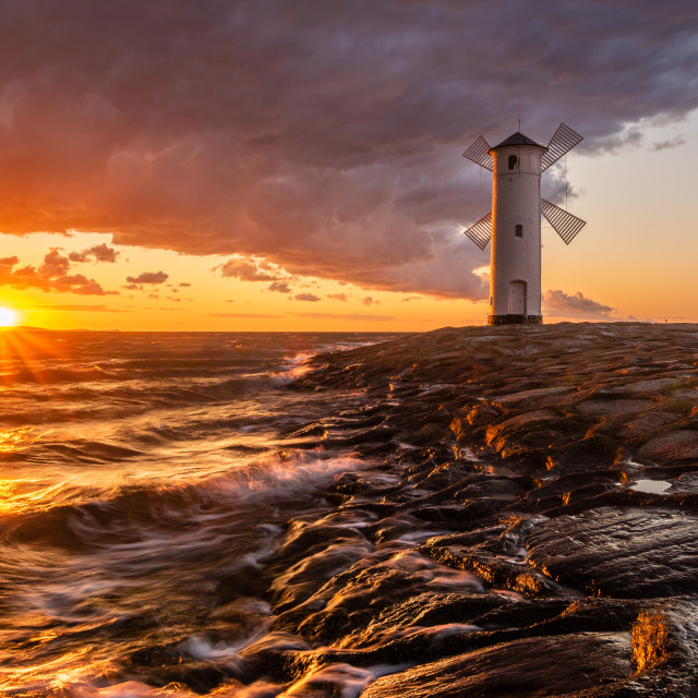 """lighthouse in the shape of a windmill in Swinoujscie in Poland d"" stock image"