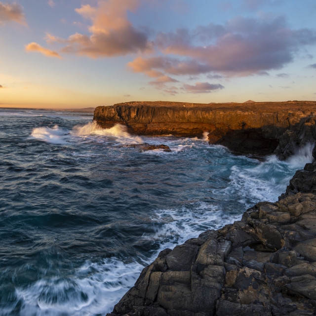 """rocky cliff in Fuerteventura during a storm at sunset"" stock image"
