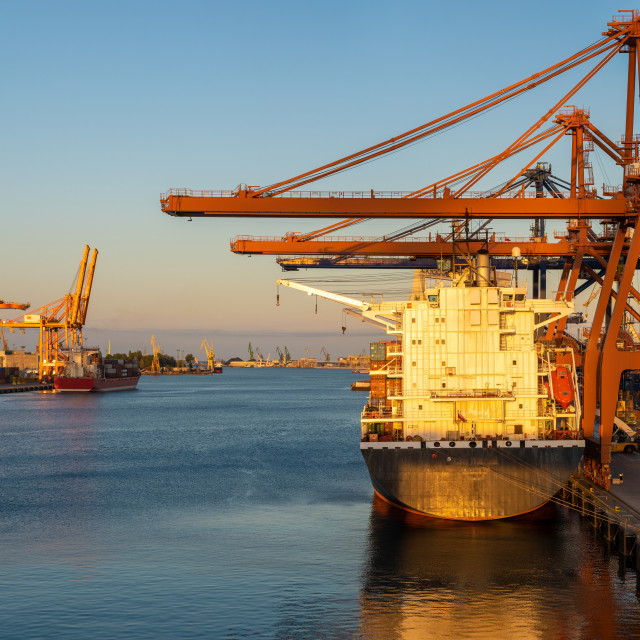 """Container port in the rays of the setting sun. Gdynia, Poland"" stock image"