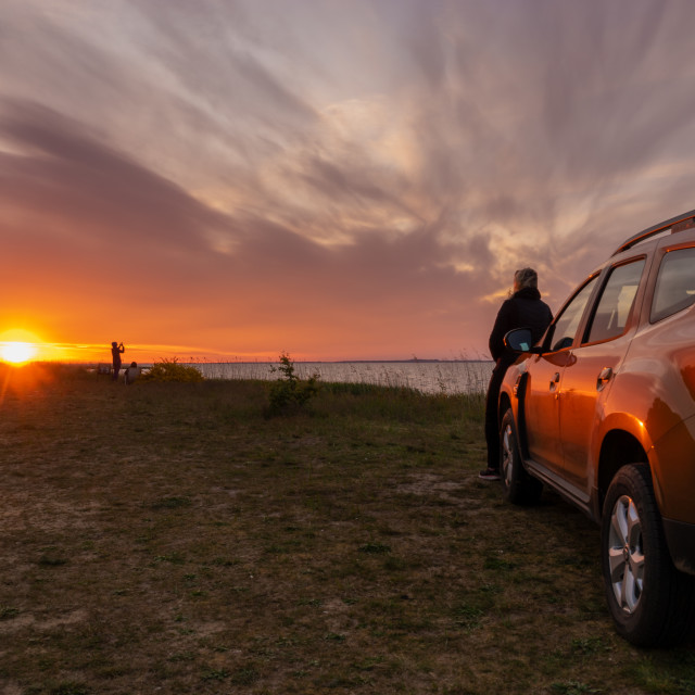 """driver, woman standing next to the Dacia Duster SUV admiring the"" stock image"