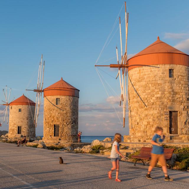 """Windmills at Mandraki Harbour"" stock image"