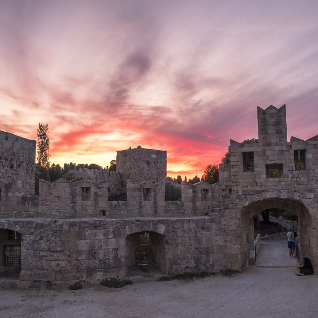 """""""The fortress wall in the harbor at sunset. Rhodes"""" stock image"""