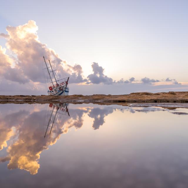 """""""Sailing boat wreck at sunset"""" stock image"""
