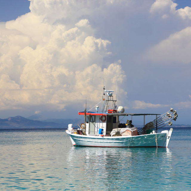 """""""Fishing boat in the Ionian sea"""" stock image"""