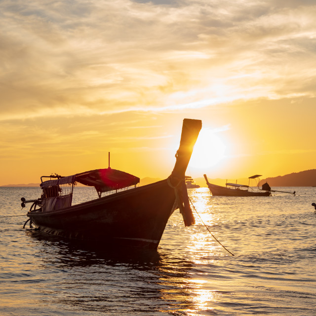 """""""Traditional long-tail boat on the beach"""" stock image"""