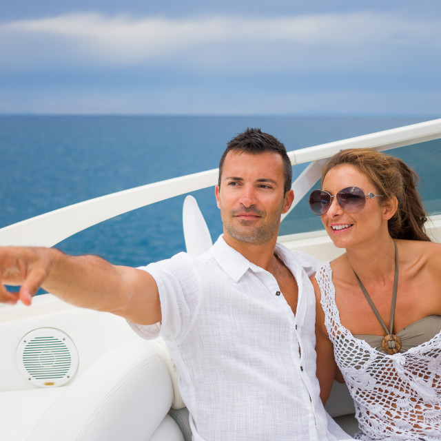 """""""happy young couple on their yacht"""" stock image"""