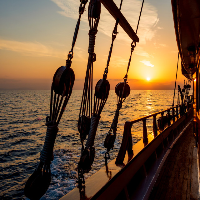 """""""Sunset at the Sailboat deck while cruising"""" stock image"""