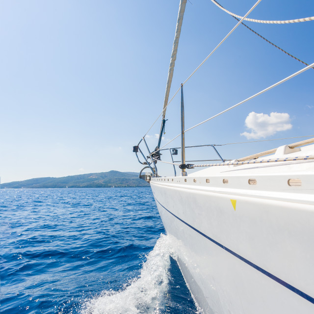 """""""Sailing boat on the water in sunshine"""" stock image"""