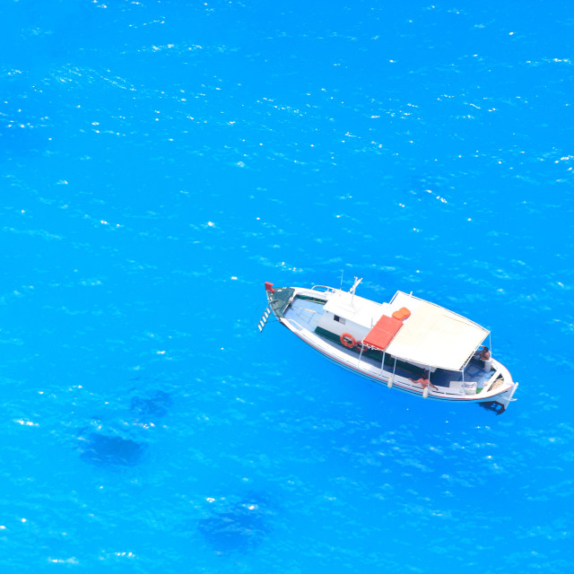 """""""boat in deep blue water"""" stock image"""