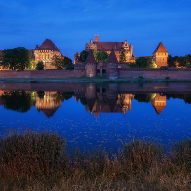 """Malbork Castle at Night in Poland"" stock image"
