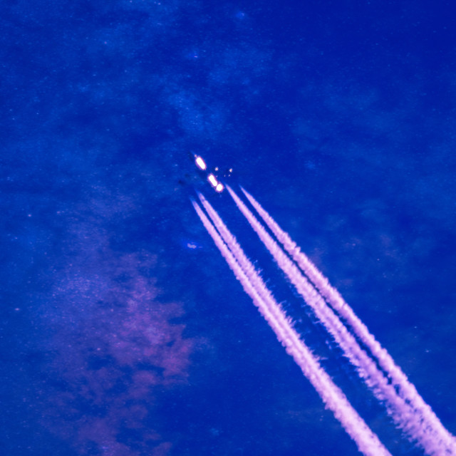 """Jet Plane with vapour trails"" stock image"