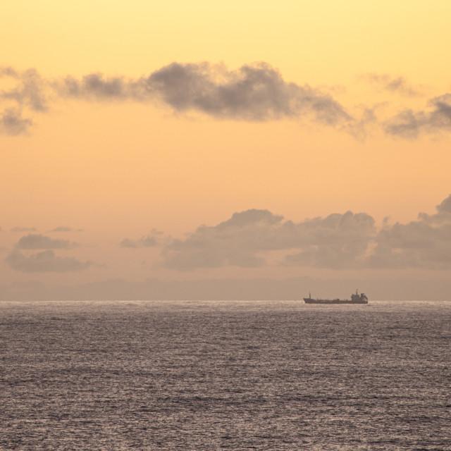 """""""Lone ship at sunrise"""" stock image"""