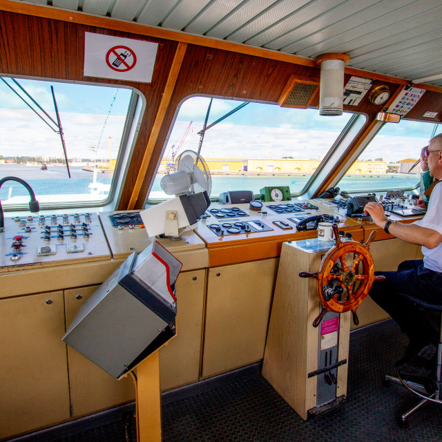 """""""Swinoujscie, Photographs of a Polish Seaport. MS/Chateaubriand, Captain on the Bridge."""" stock image"""