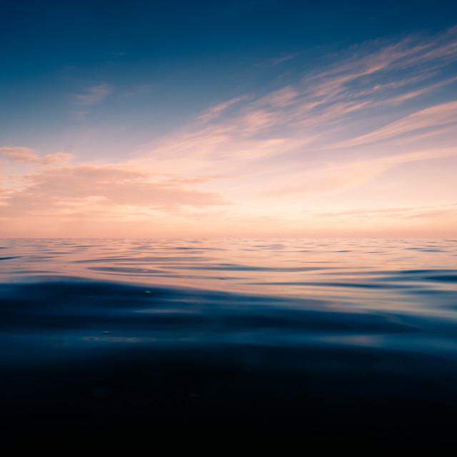 """Tranquil ocean sunset"" stock image"