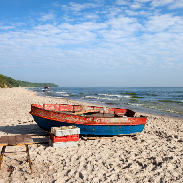"""Fishing Boat on Baltic Sea Beach"" stock image"
