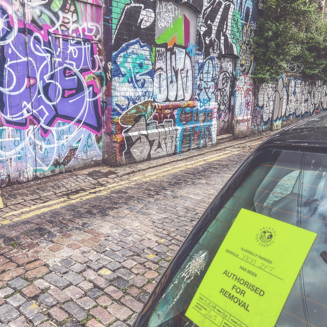 """""""Authorised for removal- is it the car or graffiti?"""" stock image"""