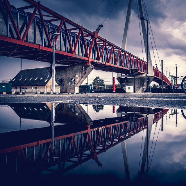 """""""Moody Reflections from Cycle Bridge, Cambridge South Train Station."""" stock image"""